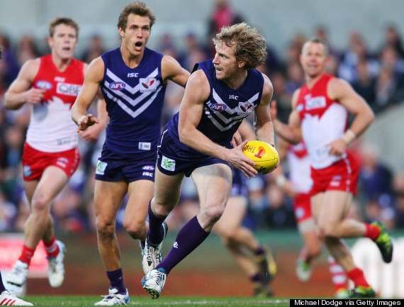 PERTH, AUSTRALIA - SEPTEMBER 21: David Mundy of the Dockers runs with the ball during the AFL Second Preliminary Final match between the Fremantle Dockers and the Sydney Swans at Patersons Stadium on September 21, 2013 in Perth, Australia. (Photo by Michael Dodge/Getty Images)